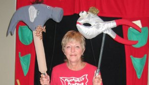 "Photo of Carol Daniel with the Hammer and Pliers puppets from ""Imagination Station"""
