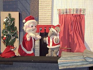 Santa and his mouse helper in their red coats lined with white fur. Rod puppets from 'Twas the Night Before Christmas