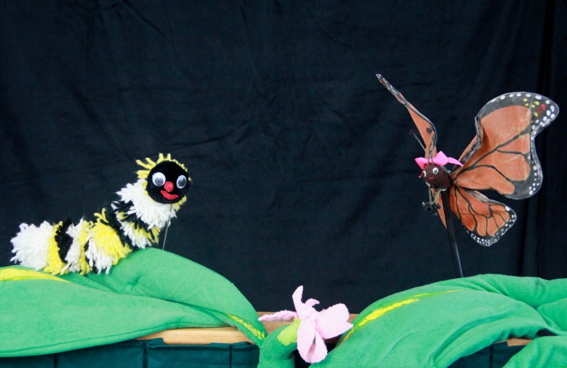 Photo of caterpillar and butterfly puppets from Butterfly Ballad