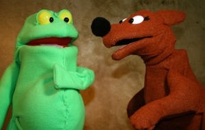 Kangaroo tries to persuade Tiddalick the Frog to share water.