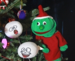 Rutherford the Electronics elf with a couple of carol-singing snowballs from PICCADILLY HOLIDAY