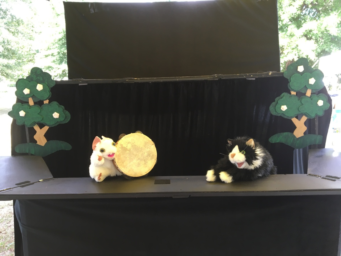 Mouse puppet with a Tamborine and cat puppet from Cat and Mouse Tales