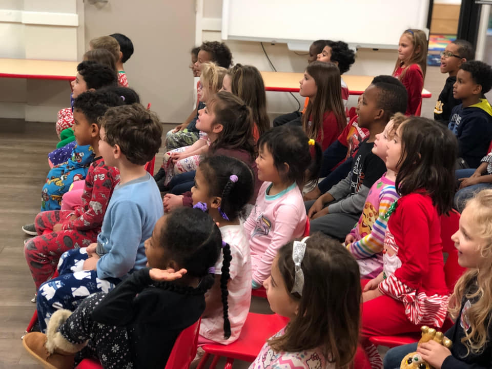Preschool children attentively watching Cat and Mouse Tales