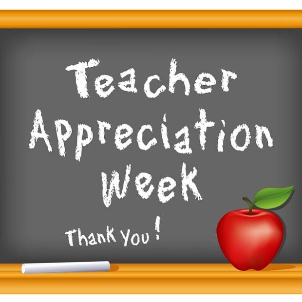 An image of a blackboard that reads Teacher Appreciation Week in chalk with an apple sitting on the blackboard rail.