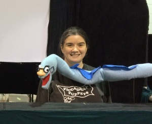 Puppeteer Lorie Summers with the Eel rod puppet