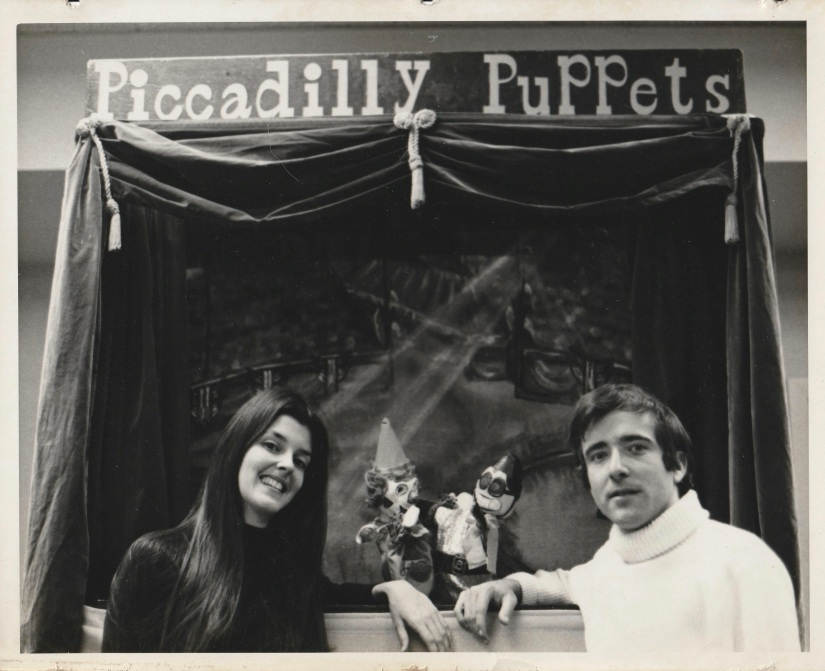 Woman and a Man with puppets in the puppet stage